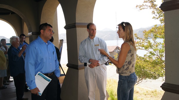 General Manager Dave Pedersen (center) speaks with local residents.