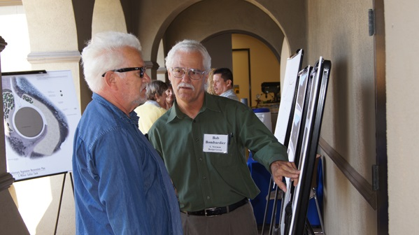 Landscape consultant Bob Bombardier discusses landscape views with a resident.