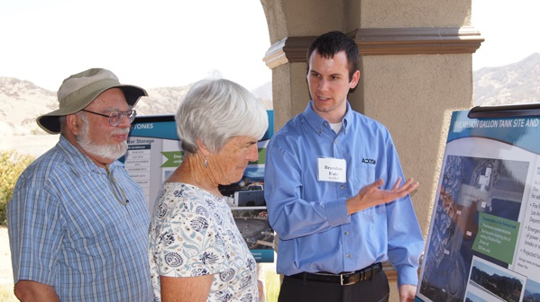 Director  and Mrs. Renger discussing the project with Brandon Hale from AECOM