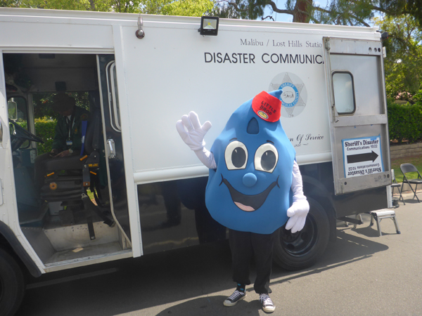 Little Drop checking out the disaster communications vehicle