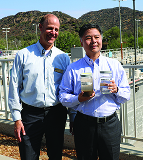 LVMWD General Manager David Pedersen and U.S. Rep. Ted Lieu showing the group the difference between untreated water and