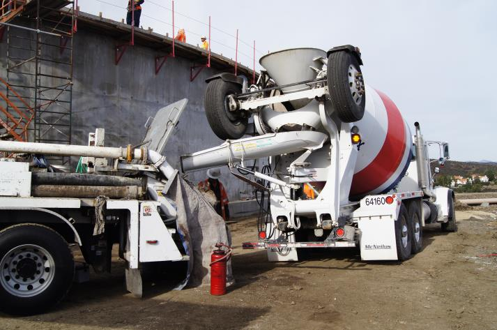 Cement truck delivering to concrete snorkel